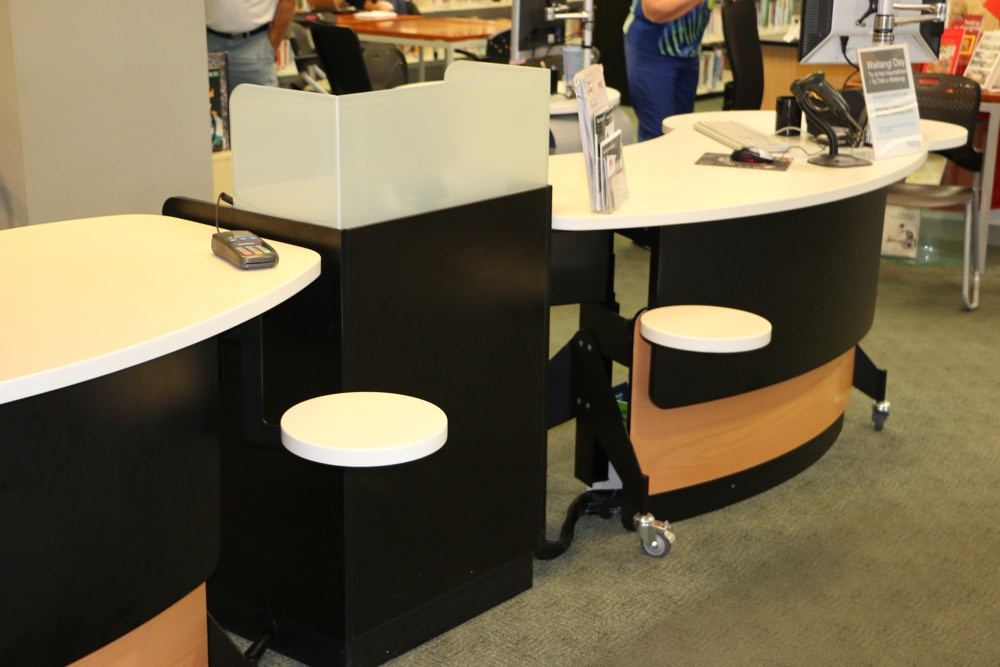 GLO 2000 Single Oval Counters form a dynamic circulation area.