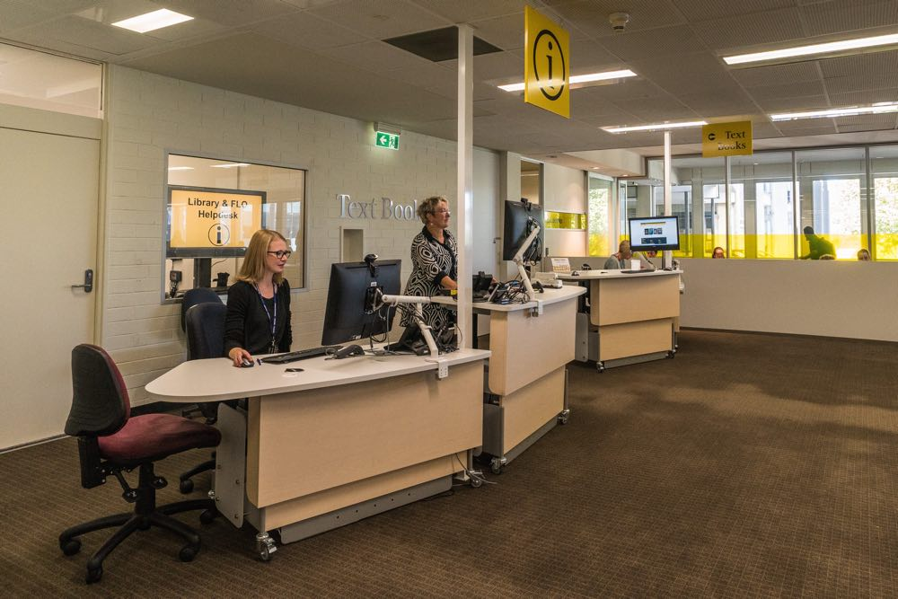 Height adjustable MAXX 1675 counters in the seated and standing positions at Flinders University.