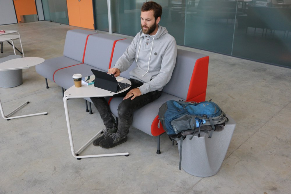 APPLE Stool becomes a handy bag rest, at Waikato University's Law and Management Building.