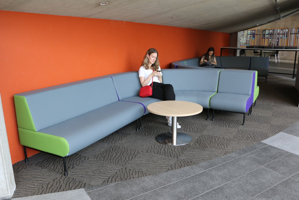 MEMPHIS Settee, MEMPHIS Radial Ottomans and MEMPHIS Single Seater deliver versatile and inviting seating, at The University of Auckland Faculty of Engineering. Seen here with our T4 LOW Round Table.