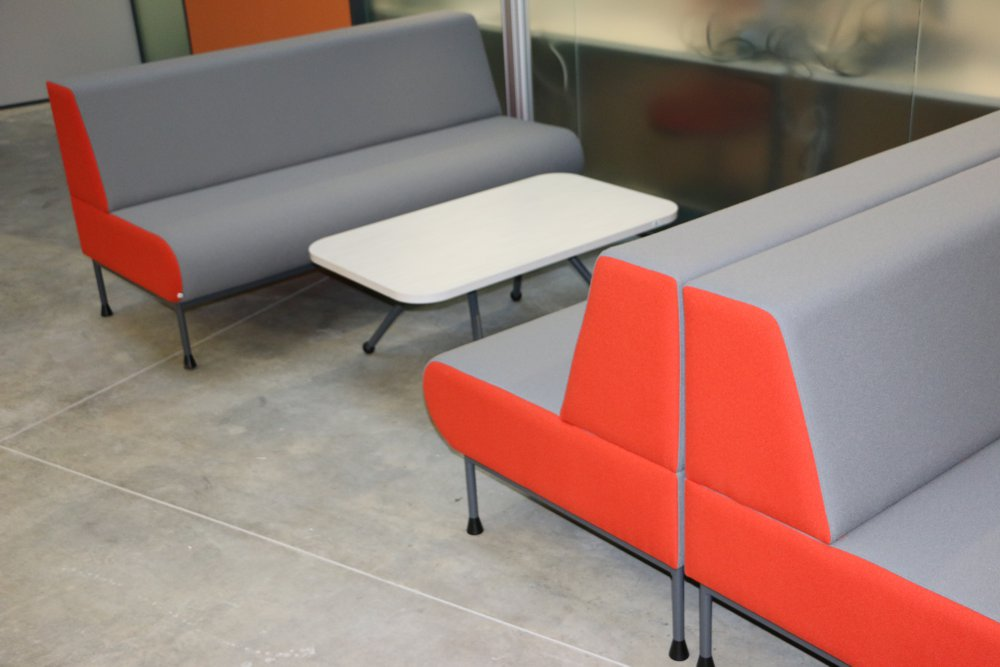 MEMPHIS Settees positioned in pairs, teamed with our EXPRESSO Linear Table, at Waikato University's Law and Management Building.