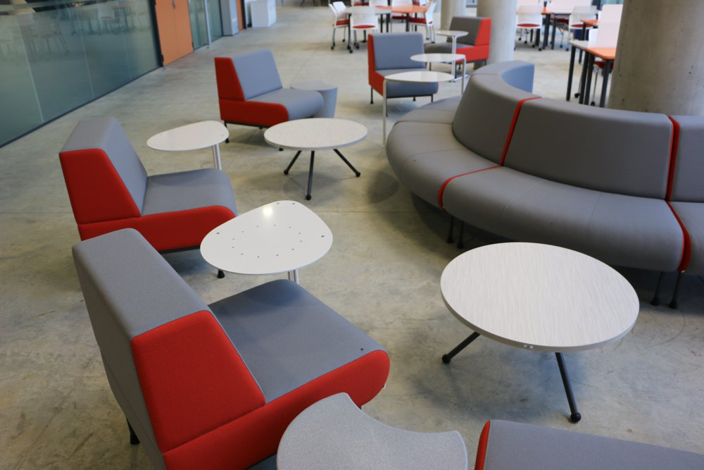 MEMPHIS Single Seater positioned for individual or collaborative study. Seen here with SPARROW Tables and EXPRESSO ROUND Table at Waikato University's Law and Management Building.