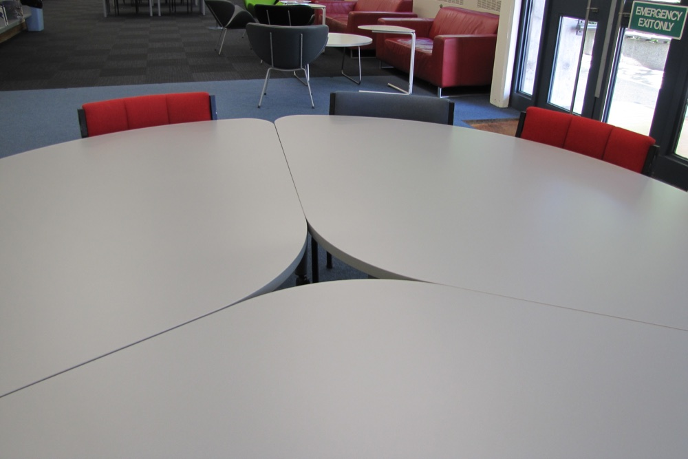 T3 TEAM Table is designed to fit neatly together, with room for a mobile power source like our HITCH Recharge Station.