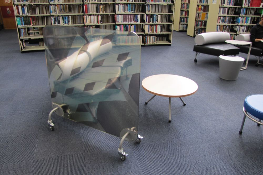 EXPRESSO Round Table with GALAXY Radial Ottomans and TO GO Screen at The University of Auckland General Library.
