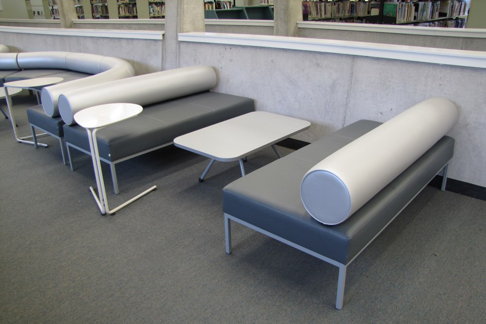 EXPRESSO Linear Table and SPARROW Table, teamed with GALAXY Lineal Ottomans at The University of Auckland's Sylvia Ashton-Warner Library.