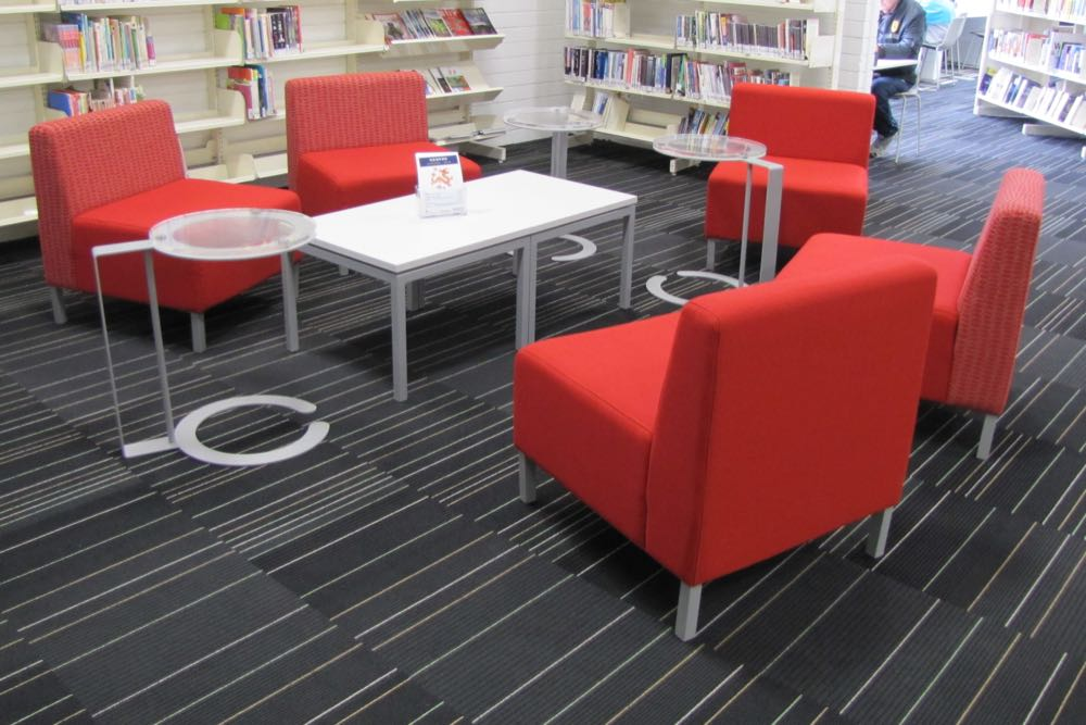 MODE Low Tables and OVERLAP Laptop Tables, teamed with lounge chairs, form an inviting informal area.