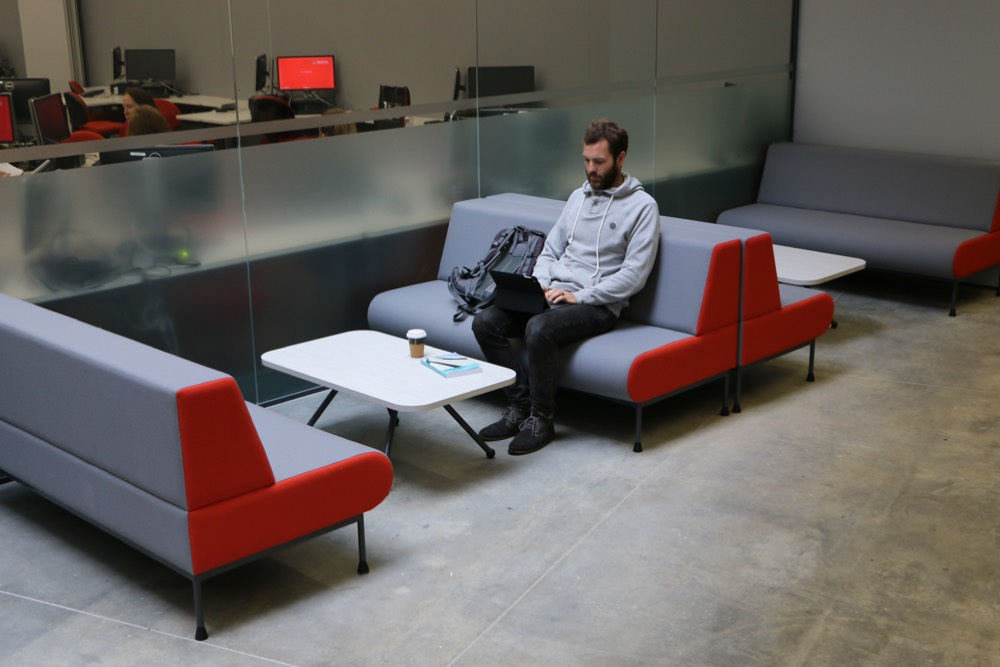 EXPRESSO Linear Table teamed with MEMPHIS Settee, at Waikato University Law and Management Building.