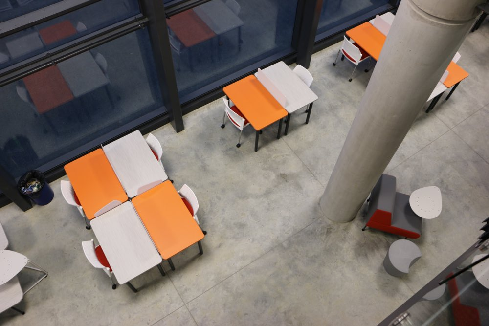 Socrates FLICK Study Stations stand out in an orange and woodgrain finish at Waikato University's Law and Management Faculty.