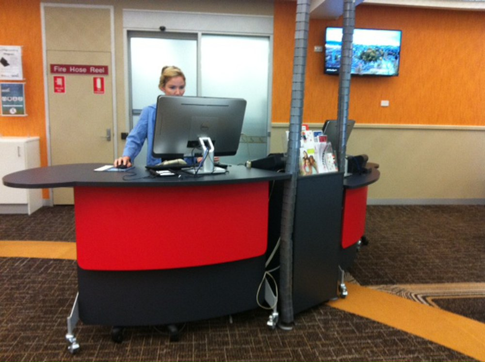 Two GLO 1600's group around a shared storage pedestal to form a service point at Casuarina Library.