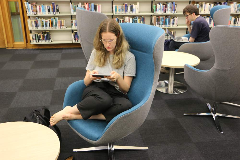 ELIZABETH Chairs — swivel to interact or swivel for privacy. Teamed with our T4 LOW Round Tables.
