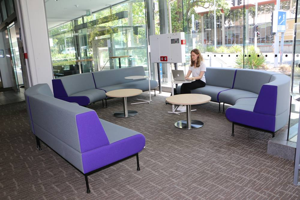 MEMPHIS Seating forms a cosy alcove in the busy Engineering School foyer. Seen here with SPARROW Laptop Table and our T4 LOW Round Pedestal Tables.